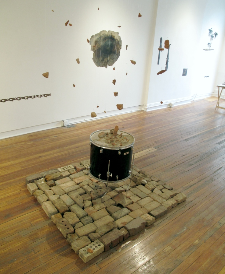 "A sane revolution, bricks, drum, fish wire, copper thread, 144"" x 53"" x 53"""